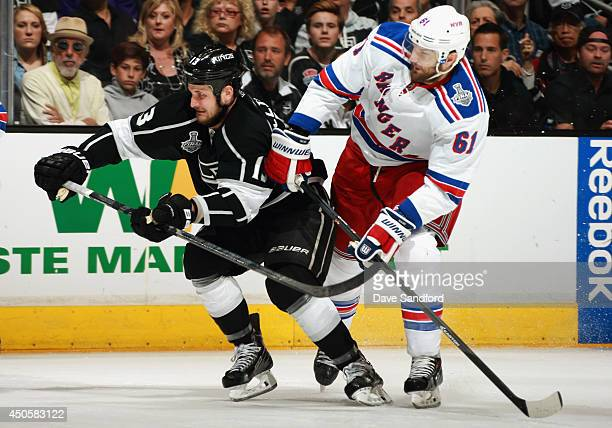 Rick Nash of the New York Rangers pressures Kyle Clifford of the Los Angeles Kings in the second period of Game Five of the 2014 Stanley Cup Final at...