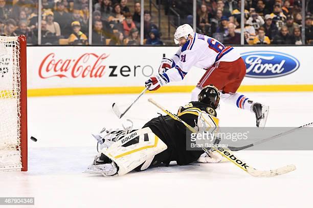 Rick Nash of the New York Rangers scores a goal against Niklas Svedberg of the Boston Bruins at the TD Garden on March 28 2015 in Boston Massachusetts