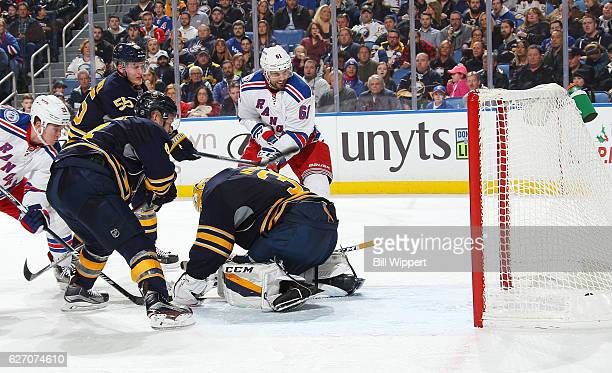 Rick Nash of the New York Rangers scores a second period goal against goaltender Anders Nilsson of the Buffalo Sabres during an NHL game at the...