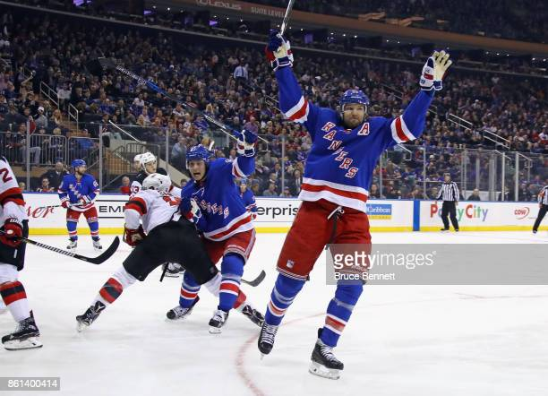 Rick Nash of the New York Rangers scores at 531 of the second period against the New Jersey Devils and is joined by Jesper Fast at Madison Square...