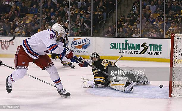 Rick Nash of the New York Rangers scores on Niklas Svedberg of the Boston Bruins in the second period against the New York Rangers at the TD Garden...
