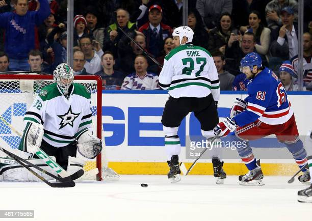 Rick Nash of the New York Rangers scores the game winning goal in the third period as Kari Lehtonen of the Dallas Stars is unable to make the stop at...