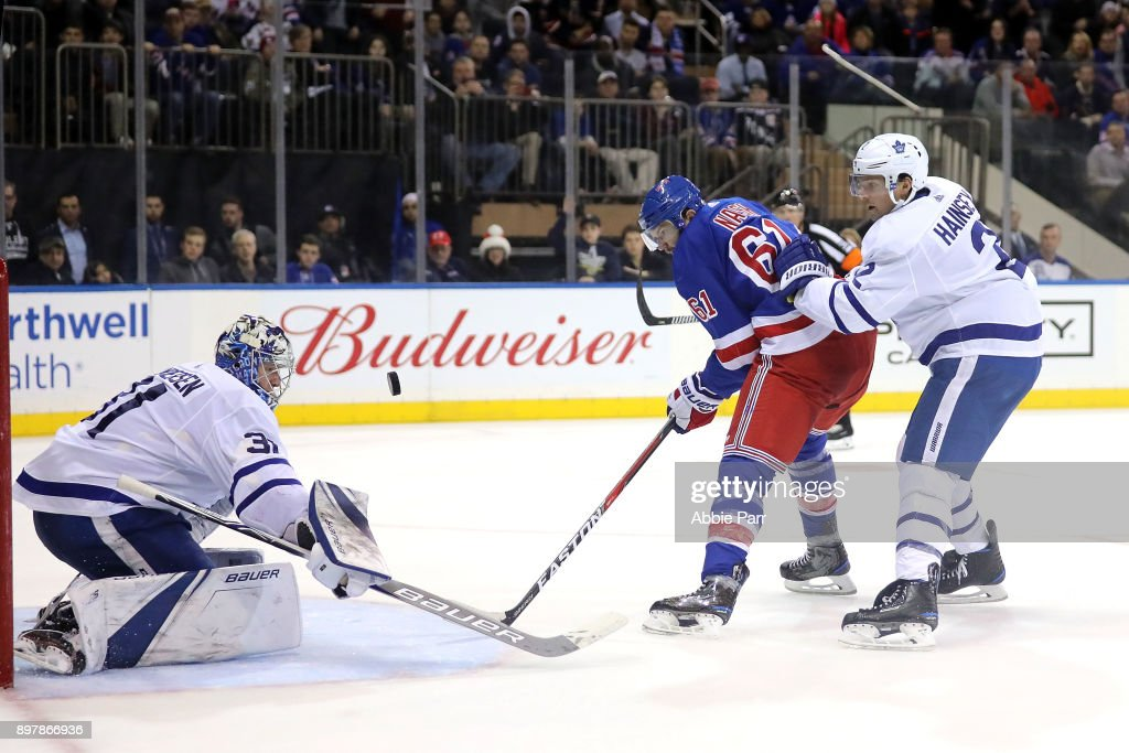 Rick Nash #61 of the New York Rangers takes a shot against Ron Hainsey #2 of the Toronto Maple Leafs in the second period during their game at Madison Square Garden on December 23, 2017 in New York City.