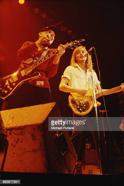 Rick Nielsen and Robin Zander performing with American rock group Cheap Trick April 1979