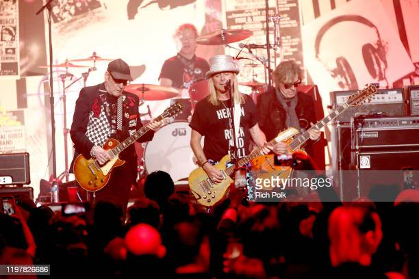 Rick Nielsen Daxx Nielsen Robin Zander and Tom Petersson of music group Cheap Trick perform onstage at The Art Of Elysium Presents WE ARE HEAR'S...