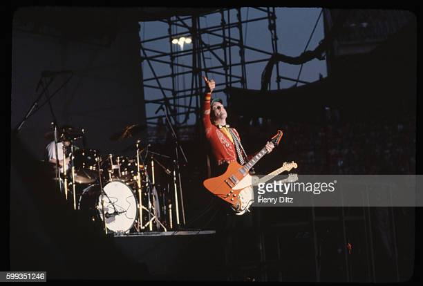 Rick Nielsen plays the guitar during a concert performance by the rock band Cheap Trick