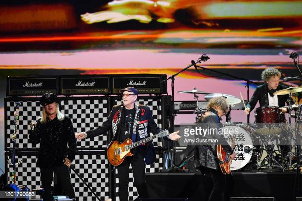 Rick Nielsen Robin Zander Tom Petersson and Daxx Nielsen of Cheap Trick perform onstage during MusiCares Person of the Year honoring Aerosmith at...