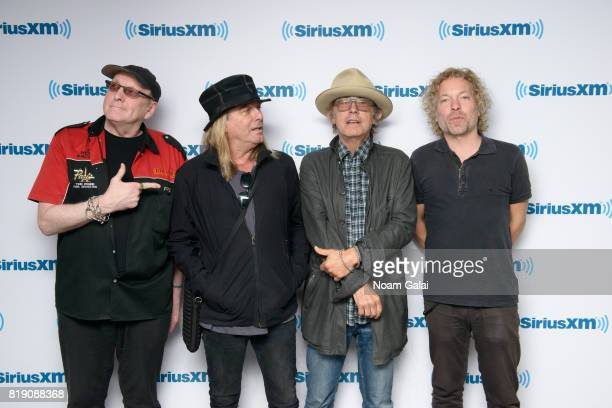 Rick Nielsen Robin Zander Tom Petersson and Daxx Nielsen of Cheap Trick visit SiriusXM Studios on July 19 2017 in New York City