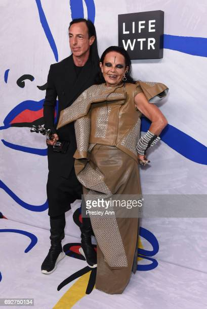 Rick Owens poses with Michèle Lamy and the Geoffrey Beene Lifetime Achievement Award on the Winners Walk during 2017 CFDA Fashion Awards at...
