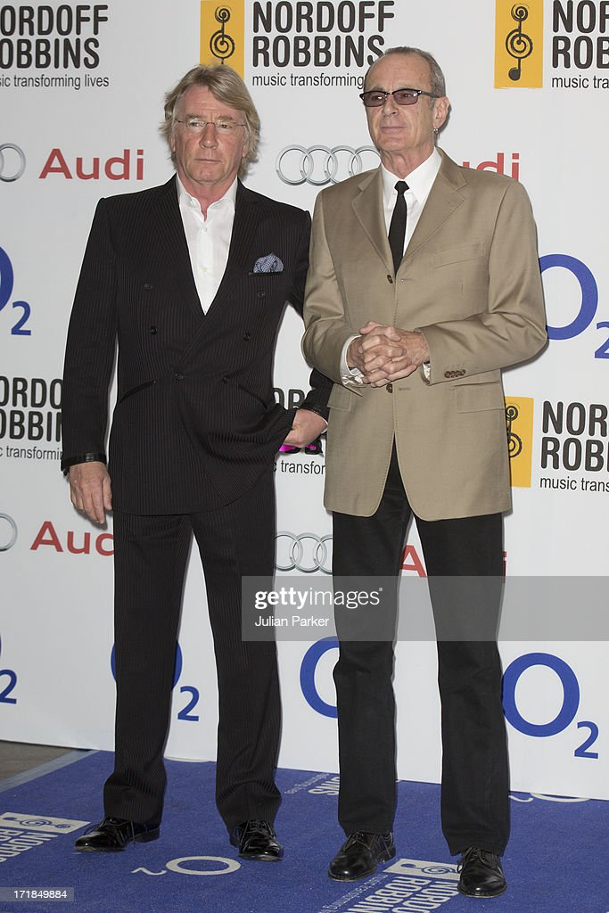 Rick Parfitt ( L ) and Francis Rossi ( R ) attend the Nordoff Robbins Silver Clef awards at London Hilton on June 28, 2013 in London, England.