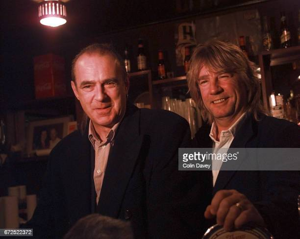 Rick Parfitt and Francis Rossi of rock band Status Quo behind the bar at the Ruskin Arms in east London 23rd March 1999