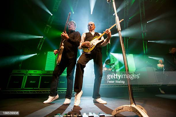 Rick Parfitt and Francis Rossi of Status Quo perform on stage at the Palladium on November 16 2012 in Cologne Germany