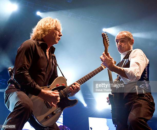 Rick Parfitt and Francis Rossi of Status Quo perform on stage at the LG Arena on December 5, 2009 in Birmingham, England.