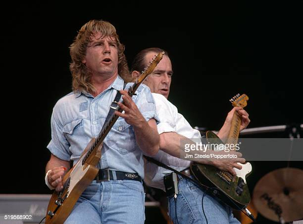 Rick Parfitt and Francis Rossi of Status Quo performing on stage at Wembley Stadium in London on the 15th June, 1991.