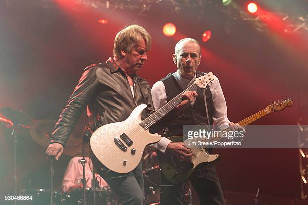 Rick Parfitt and Francis Rossi of Status Quo performing on stage at Wembley Arena in London on the 17th March 2013