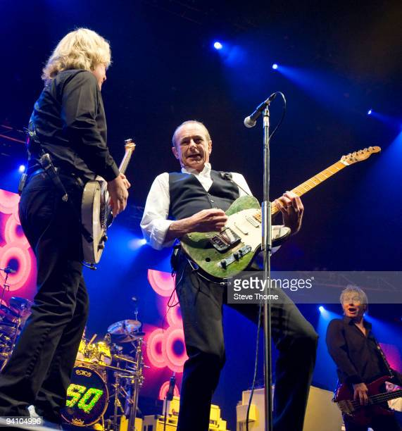 Rick Parfitt, Francis Rossi and John Edwards of Status Quo perform on stage at the LG Arena on December 5, 2009 in Birmingham, England.
