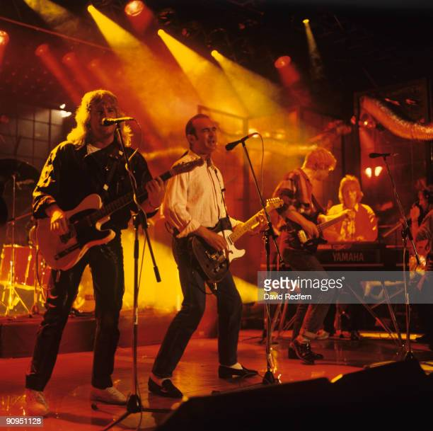 Rick Parfitt Francis Rossi John Edwards and Andy Bown of Status Quo perform on stage at the Montreux Rock Festival held in Montreux Switzerland in...