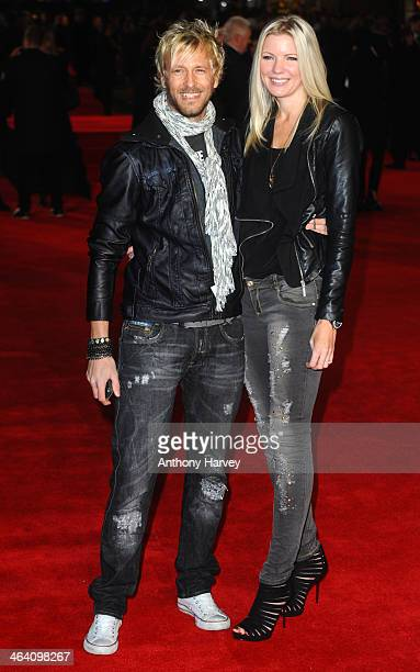 Rick Parfitt Jr and his wife attend the UK Premiere of 'Jack Ryan Shadow Recruit' at Vue Leicester Square on January 20 2014 in London England