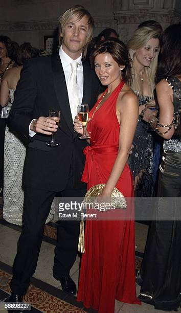 Rick Parfitt Jr and singer Dannii Minogue attend Andy and Patti Wongs Chinese New Year Party at the Royal Courts Of Justice on January 28 2006 in...