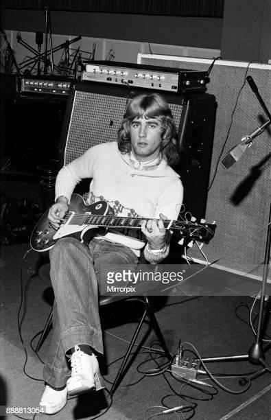 Rick Parfitt lead guitar in the rock group Status Quo rehearses in the studio His hearing is now affected because of the kind of music played by the...