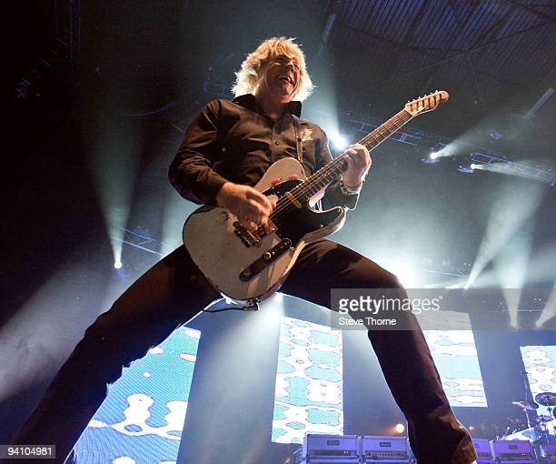 Rick Parfitt of Status Quo performs on stage at the LG Arena on December 5, 2009 in Birmingham, England.