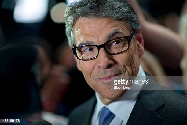 Rick Perry former governor of Texas and 2016 Republican presidential candidate pauses while speaking to the media in the spin area after a televised...