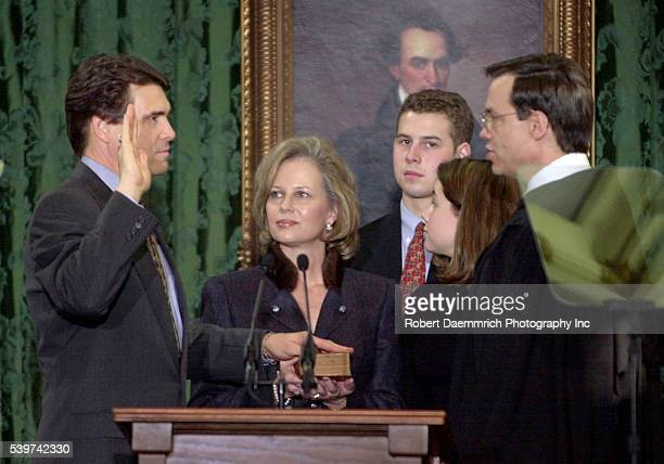 Rick Perry is swornin as Governor of Texas as his wife Anita his son Griffin and his daughter Sydney look on At the far right is Texas Supreme Court...