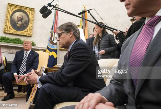 Rick Perry US secretary of energy center listens during a meeting with US President Donald Trump left and Mohammed bin Salman Saudi Arabia's crown...
