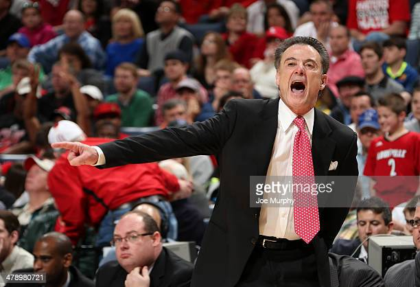 Rick Pitino head coach of the Louisville Cardinals coaches from the sideline against the Connecticut Huskies during the Championship of the American...