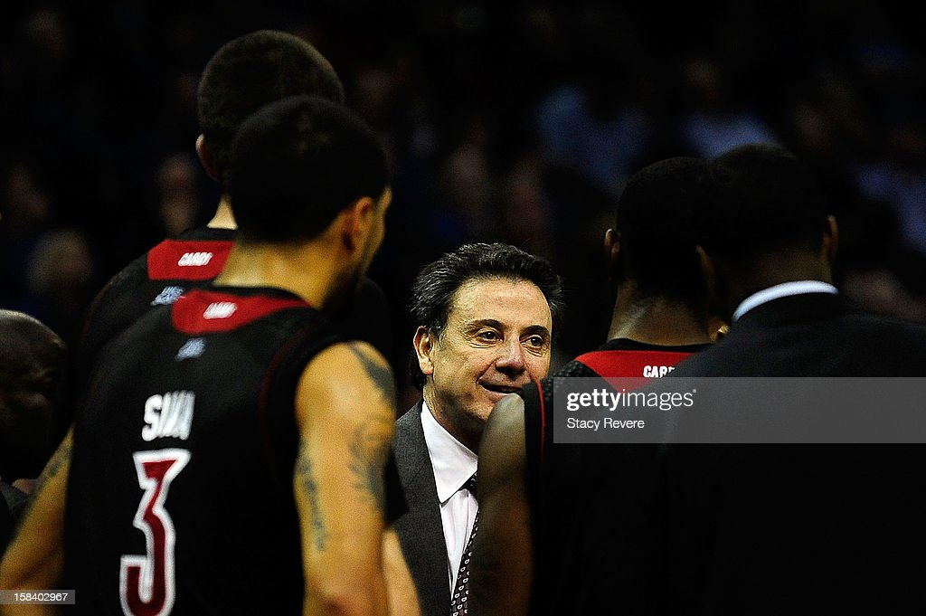 Rick Pitino, head coach of the Louisville Cardinals, speaks with his team during a time out against the Memphis Tigers during a game at FedExForum on December 15, 2012 in Memphis, Tennessee.