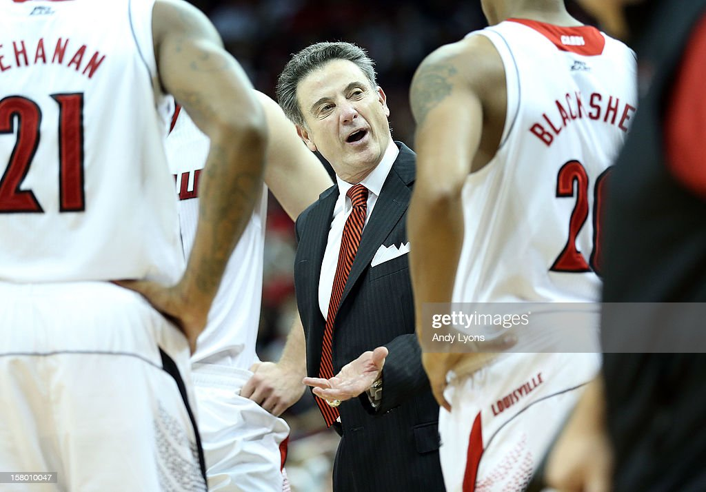 Rick Pitino the head coach of the Louisville Cardinals gives instructions to his team during the game against the Missouri-Kansas City Kangaroos at KFC YUM! Center on December 8, 2012 in Louisville, Kentucky.