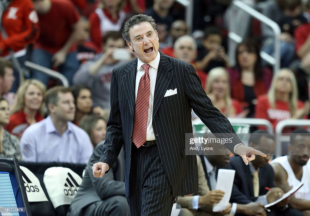 Rick Pitino the head coach of the Louisville Cardinals gives instructions to his team during the game against the St. John's Red Storm at KFC YUM! Center on February 14, 2013 in Louisville, Kentucky.