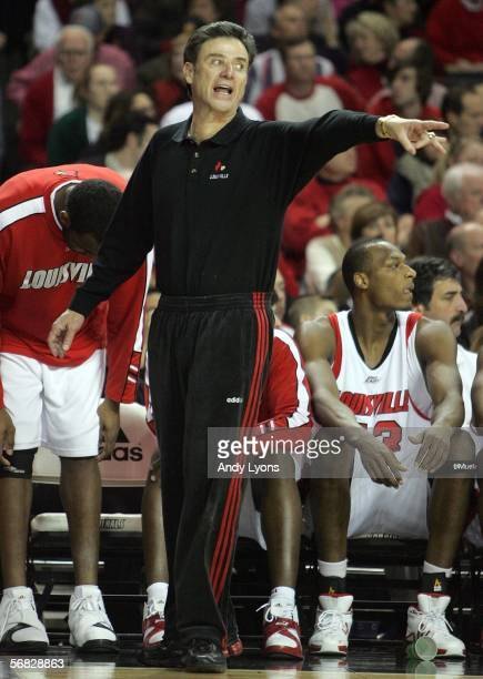 Rick Pitino the Head Coach of the Louisville Cardinals gives instructions to his team during the game against the South Florida Bulls on February 11...