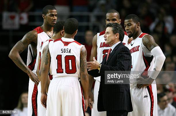 Rick Pitino the Head Coach of the Louisville Cardinals gives instructions to his team during the Big East Conference game against the Notre Dame...