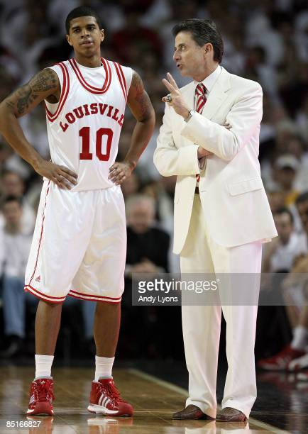 Rick Pitino the Head Coach of the Louisville Cardinals gives instructions to Edgar Sosa during the Big East Conference game against the Marquette...