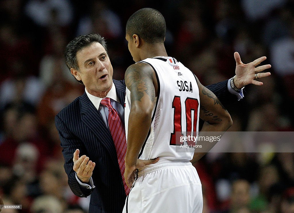 Rick Pitino the Head coach of the Louisville Cardinals gives instructions to Edgar Sosa #10 during the game against the Morgan State Bears on November 22, 2009 at Freedom Hall in Louisville, Kentucky. Louisville won 90-81.