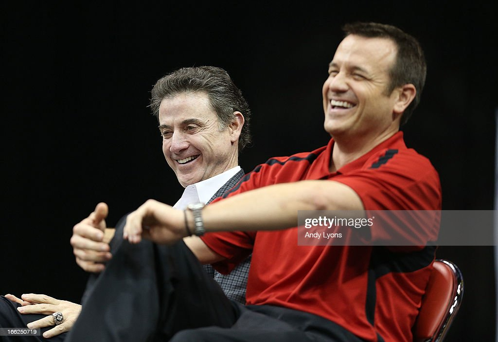 Rick Pitino the Mens head coach and Jeff Waltz the head coach of the Louisville Cardinals Womens team talks during the Louisville Cardinals NCAA Basketball Celebration to mark the NCAA championship by the Mens team and the runner-up finish by the womens team at KFC YUM! Center on April 10, 2013 in Louisville, Kentucky.