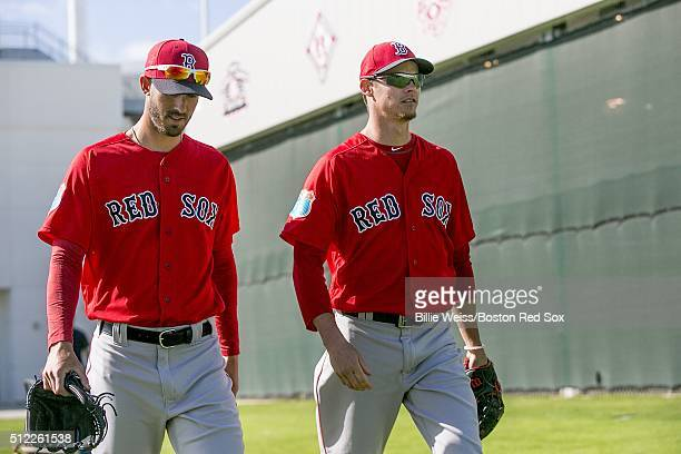 Rick Porcello and Clay Buchholz of the Boston Red Sox walk toward the field during a team workout on February 25 2016 at Fenway South in Fort Myers...