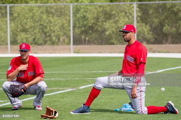 Rick Porcello and David Price of the Boston Red Sox look on during a team workout on February 21 2017 at Fenway South in Fort Myers Florida