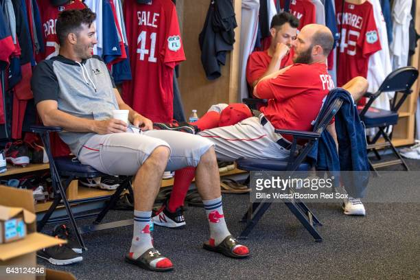 Rick Porcello and Dustin Pedroia of the Boston Red Sox talk during a team workout on February 20 2017 at Fenway South in Fort Myers Florida
