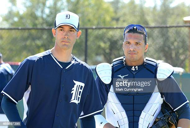 Rick Porcello and Victor Martinez of the Detroit Tigers look on during the spring training workout day at the TigerTown Complex on February 14 2014...