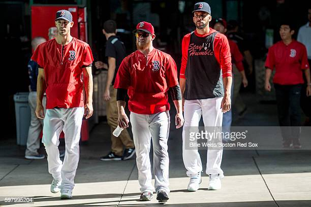 Rick Porcello Craig Kimbrel and David Price of the Boston Red Sox walk through the concourse before a game against the Tampa Bay Rays on August 30...