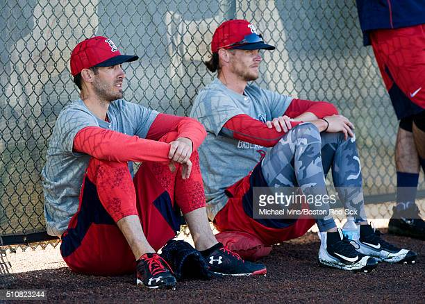 Rick Porcello left and Clay Buchholz of the Boston Red Sox wait for their turn to pitch during a Spring Training workout on February 17 2016 at...