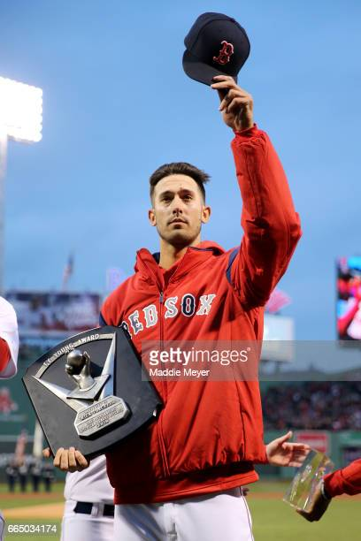 Rick Porcello of the Boston Red Sox acknowledges fans after receiving his Cy Young award before the game against the Pittsburgh Pirates at Fenway...