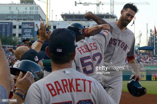 Rick Porcello of the Boston Red Sox celebrates with teammates after driving in three runs with a double in the second inning against the Washington...