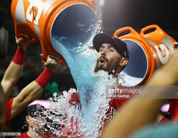 Rick Porcello of the Boston Red Sox gets a Gatorade bath from team mate Andrew Benintendi of the Boston Red Sox after the win over the New York...