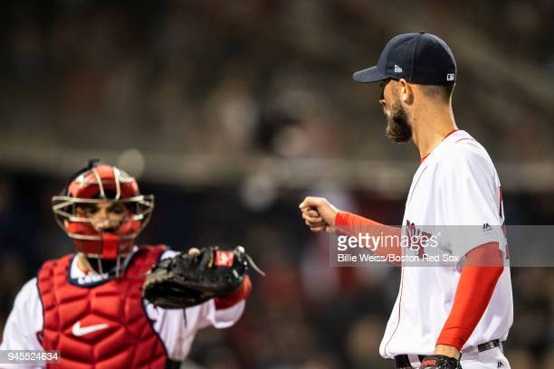 Rick Porcello of the Boston Red Sox high fives Sandy Leon during the seventh inning of a game against the New York Yankees on April 12 2018 at Fenway...