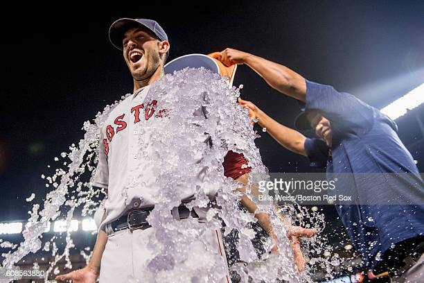 Rick Porcello of the Boston Red Sox is given an ice bath after pitching a complete game against the Baltimore Orioles on September 19 2016 at Oriole...