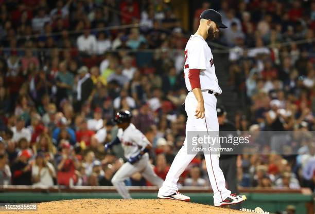 Rick Porcello of the Boston Red Sox reacts after giving up a two-run home run to Greg Allen of the Cleveland Indians in the seventh inning of a game...