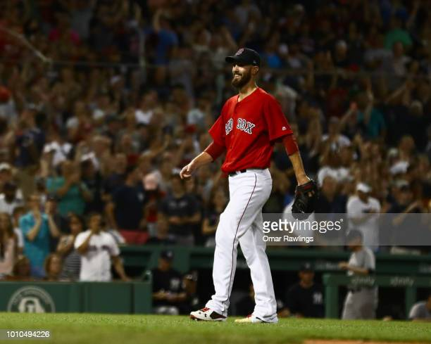 Rick Porcello of the Boston Red Sox smiles as he walks of the mound in the ninth inning of the game and victory over the New York Yankees at Fenway...
